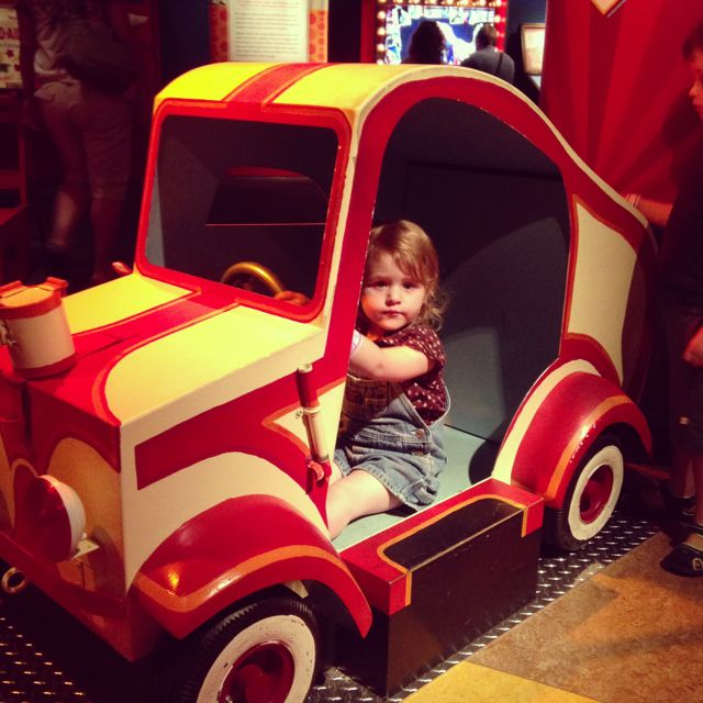 L in car at circus museum